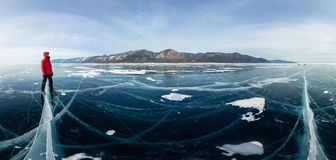 Panorama man stand on cracks on blue ice of Lake Baikal from Olkhon.  stock image