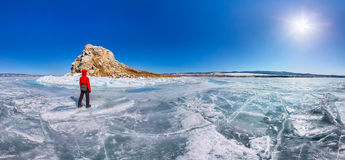 Panorama man tourist standing at the island Yador on blue ice of Stock Images