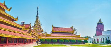 Panorama of Mandalay Palace`s courtyard, Myanmar. MANDALAY, MYANMAR - FEBRUARY 23 ,2018: Panoramic view on courtyard of Royal Palace with beautiful buildings in royalty free stock photo