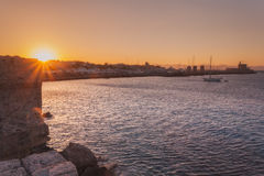 Panorama Mandraki port at sunset. Rhodes Island. Greece. Attraction of the island of Rhodes is the capital of the ancient port of Mandraki. Statue Colossus of stock image