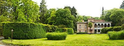 Panorama of manor house with  green meadow Royalty Free Stock Photos