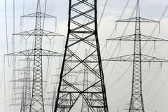 Panorama of many electric power poles Royalty Free Stock Photos