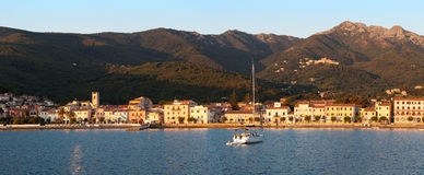 Panorama of Marciana Marina harbour with Monte Cappane mountain Stock Images