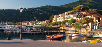 Panorama of Marciana Marina harbour with Monte Cappane mountain Royalty Free Stock Image