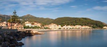 Panorama of Marciana Marina promenade, Monte Cappane mountain Stock Image