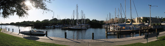 Panorama of marina sidewalk. This is a panorama of the sidewalk and the boats in the water in a marina royalty free stock image