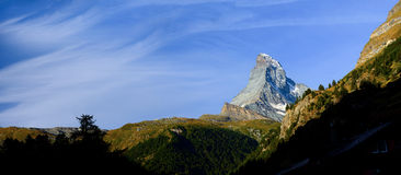 Panorama of Matterhorn in early morning with blue sky in summer. Stock Photo