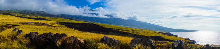 Panorama Maui mountains and shoreline. Rural unpaved road around Maui north shore has few travelers royalty free stock photos
