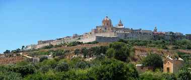 Panorama of Mdina`s St. Paul`s Cathedral from the countryside be. Panorama of the old capital Mdina with St. Paul`s Cathedral surrounding by the fortress wall Stock Images