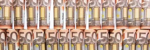 Panorama med rullande 50 euroanmärkningar Arkivfoton