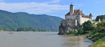 Panorama of the medieval castle on a river. Stock Photography