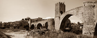 Panorama of medieval stone bridge. Imitation of old image Royalty Free Stock Photos