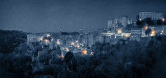 Panorama of medieval town at rainy night Stock Photo