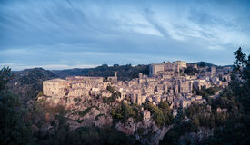 Panorama of medieval town Sorano at twilight. Tuscany, Grosseto, Italy stock image