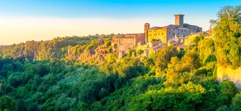 Panorama of a medieval village at sunset in Tuscany royalty free stock photos