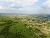 Panorama of the mestain near the town of Jaslo in Poland from a bird`s eye view. Aerial photography of landscapes and settlements. Urbanization of the country royalty free stock photos