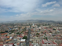 Panorama of a Mexico City. Mexico City in a sunny afternoon with trees, few local people and white and in Tlacotalpan mountain ridge close to tropics in Central Royalty Free Stock Photo