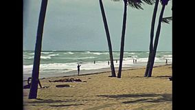 Miami Beach 1970s. Panorama of the Miami Beach in Florida and its tropical sea, the long white beaches and popular seafront street in 70`s with few tourists and stock footage