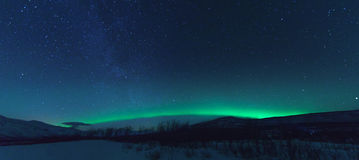 Panorama with Milky way and Northen lights Aurora. royalty free stock images