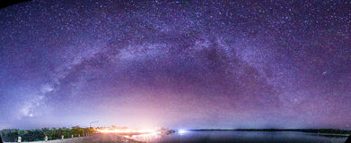 The Panorama Milky Way rises over the dam in Thailand. Stock Photo