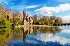 Panorama of Minnewater lake and people in cafe at Castle de la Faille, Bruges, Belgium Royalty Free Stock Photography