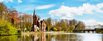 Panorama of Minnewater lake and people in cafe at Castle de la Faille, Bruges, Belgium Royalty Free Stock Image