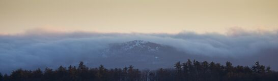 Panorama of mist over mountains royalty free stock photo