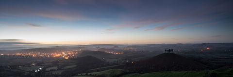 Panorama misty countryside landscape vibrant dawn sunrise Royalty Free Stock Images