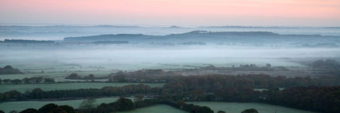 Panorama misty countryside landscape vibrant dawn sunrise Royalty Free Stock Photo