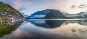 Panorama of misty lake at dawn in Hallstatt, Austria Royalty Free Stock Photo