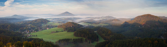 Panorama of misty landscape in morning sun Stock Images