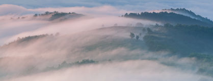 Panorama of misty morning in the mountains Stock Photos