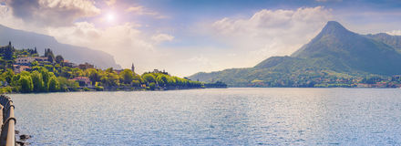 Panorama of the misty morning on the same town and lake Lecco Royalty Free Stock Photos