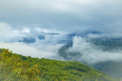 Panorama of misty mountain tops Royalty Free Stock Photography