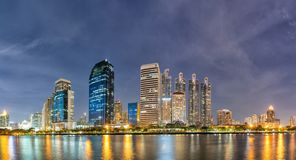 Panorama,Modern buildings and business district cityscape from urban park,night view,cityscape image of Benchakitti Park,Bangkok, royalty free stock photo
