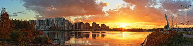 Panorama of the modern city. Stitched Panorama of the modern city against the background of a decline Stock Image