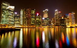 Panorama of modern skyscrapers Singapore at night time with water lite reflections. Travel. Royalty Free Stock Photos