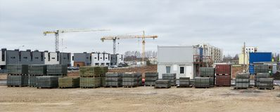 Panorama of a modern standard construction site in a small European city. All logos and trademarks is removed. Panoramic collage from several outdoor cloudy royalty free stock photo