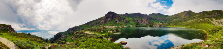Panorama of a mointain lake Stock Images