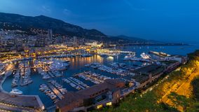 Panorama of Monte Carlo day to night timelapse from the observation deck in the village of Monaco with Port Hercules. Panorama of Monte Carlo day to night stock footage