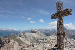 Panorama from Monte Sella du Sennes. The beautiful cross placed on the top of the Monte Sella du Sennes (Alto Adige Stock Images