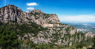 Panorama of Montserrat rocks with built monastery located near Barcelona, Spain.  stock photo