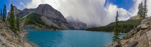 Panorama of Moraine Lake in Banff National Park Alberta Canada. On a stormy day Stock Image