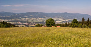 Panorama of Moravskoslezske Beskydy mountains from meadows near Bahenec settlement Stock Photo
