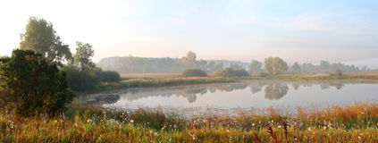 Panorama of morning lake in fog Royalty Free Stock Photos