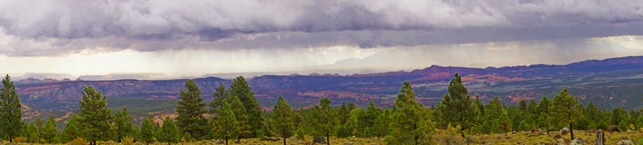 Panorama, morning thunderstorms over desert mountains Royalty Free Stock Images