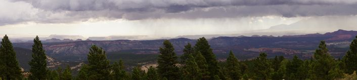 Panorama, morning thunderstorms over desert mountains Stock Photography