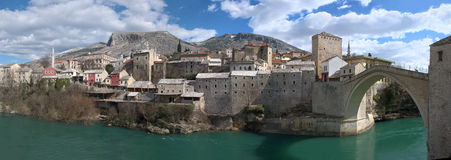 Panorama of Mostar Old Town with Old Bridge. Panorama of Mostar old town east side with Old Bridge on a sunny winter day Stock Image