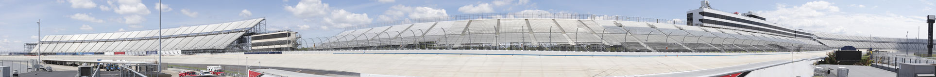 Panorama of Motor Speedway. From infield with empty stands royalty free stock photos