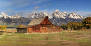Panorama of Moulton's Barn and the Grand Tetons Stock Photo